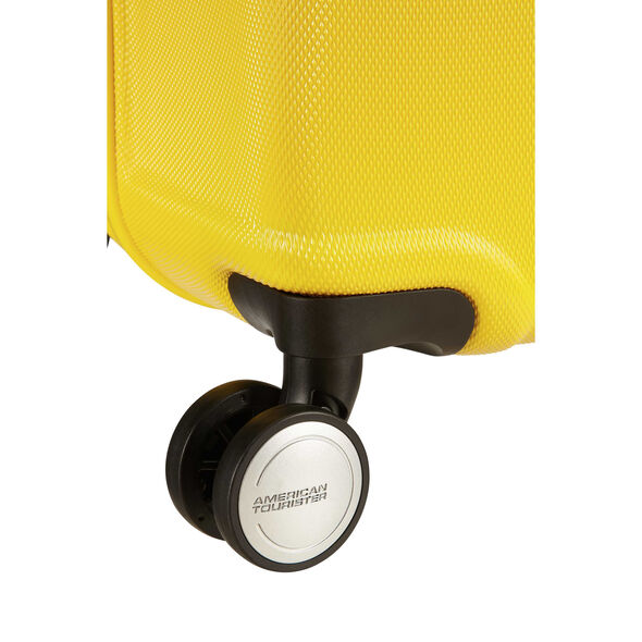 """American Tourister Wavebreaker 20"""" Spinner in the color Sunny Yellow."""