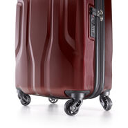 Samsonite Tribute NXT Spinner Medium in the color Red.