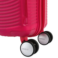 American Tourister Curio Spinner Medium in the color Pink.