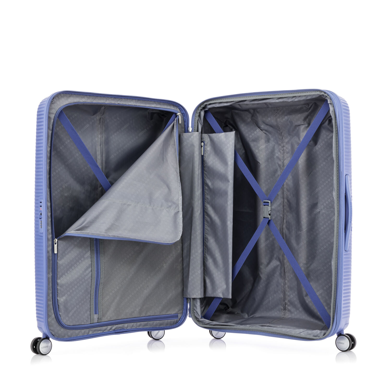 064496c4c American Tourister Curio Spinner Carry-On in the color Denim Blue.