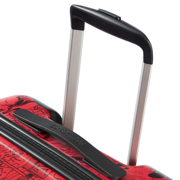 American Tourister Wavebreaker-Disney Spinner Carry-On in the color Mickey Comics Red.